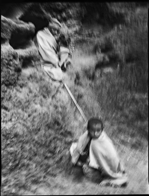 Prêtre et enfant à Lalibela en Ethiopie